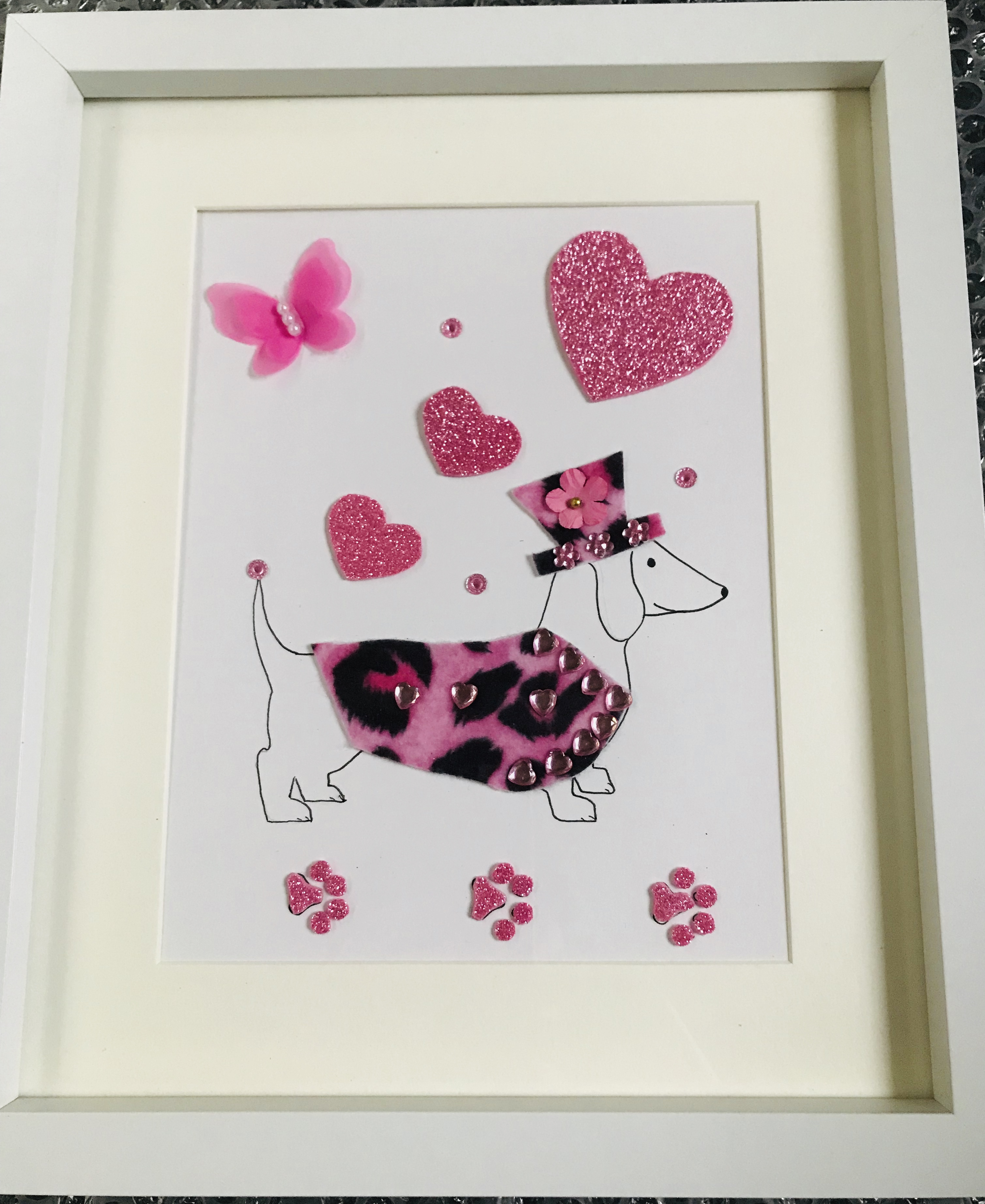 Sausage dog in pink leopardskin coat and matching hat framed wall art